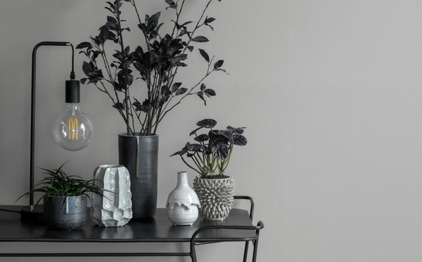 Lene Bjerre trolley decorated with a classic black lamp, vases and flowerpots