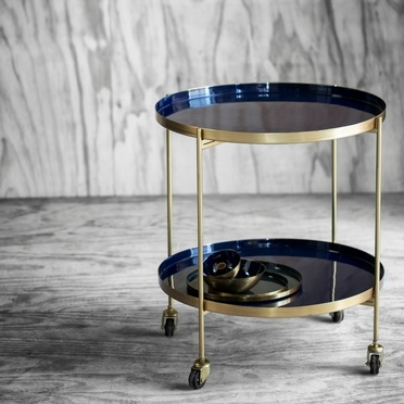 Nara trolley designed in a deep blue colour with golden details