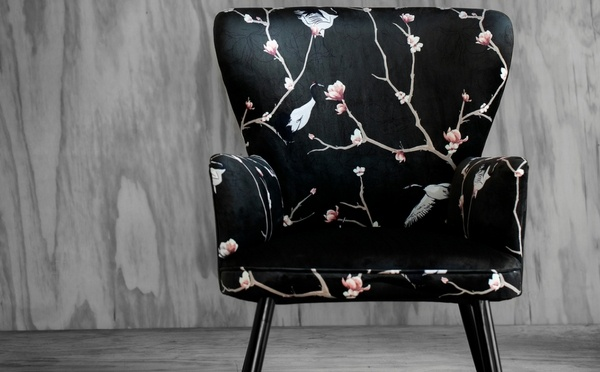 Black chair with magnolia and crane motif