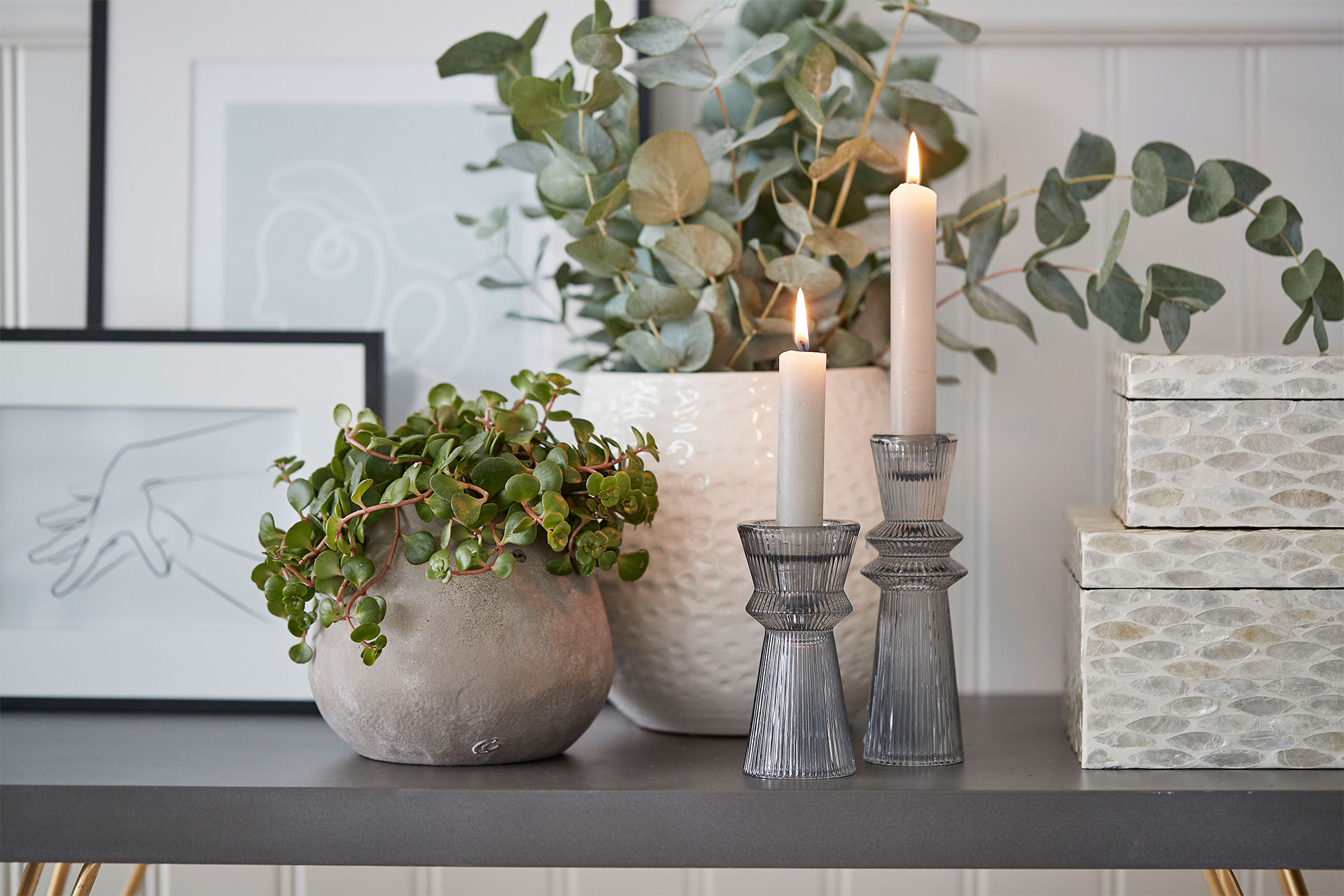 Combine handmade flower pots with candlelight from candlesticks - Lene Bjerre