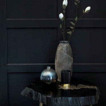 Black table decorated with grey vases
