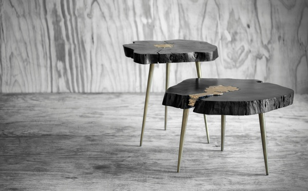 Rustic black sidetables made of wood with golden effects