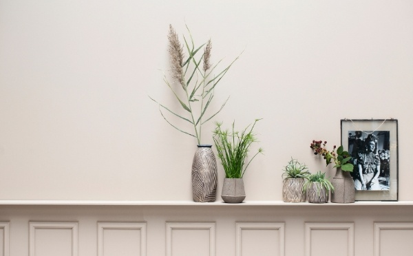 Lene Bjerre vases standing on shelf with green plants