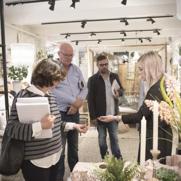 Sales Coordinator showing products in the Lene Bjerre showroom in Copenhagen