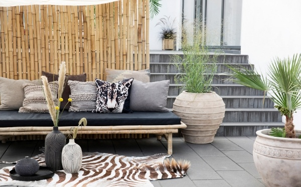 Daybed covered with African inspired cushions