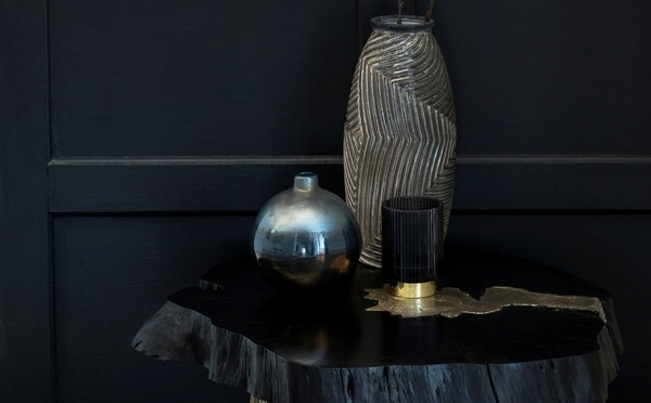 Kintsugi inspired black table with home decor on it