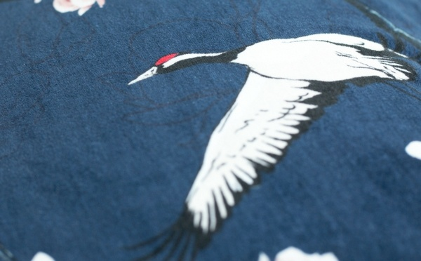 White crane print on blue fabric