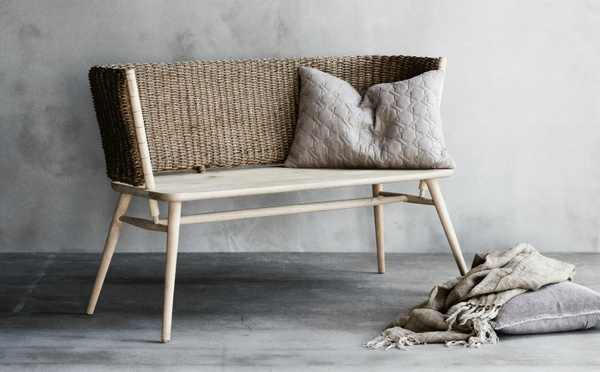 Brown handmade wooden bench with grey pillows