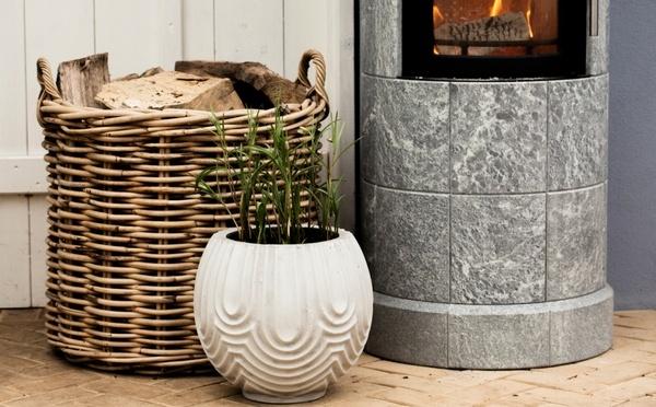 White flower pot beside a fireplace