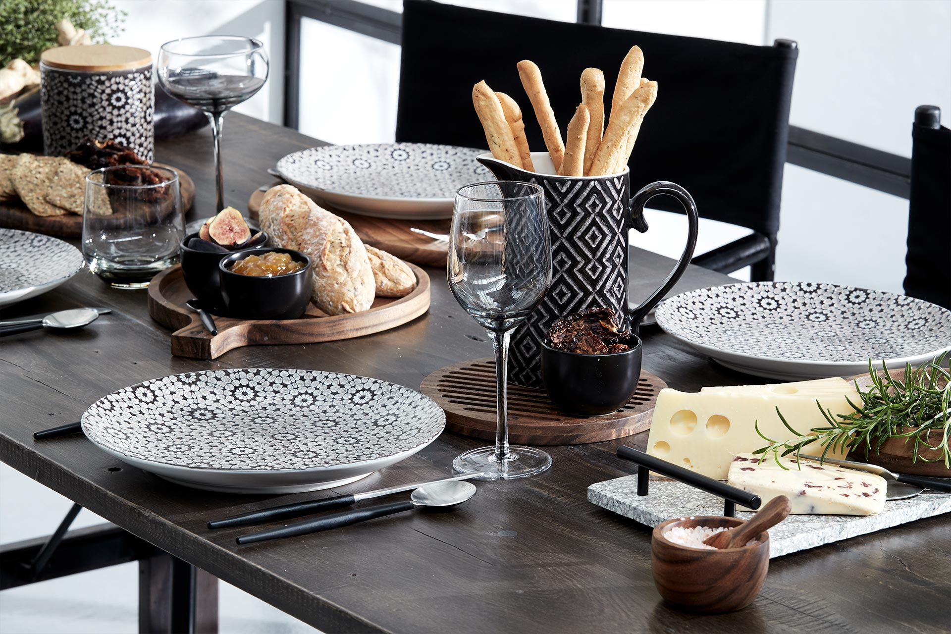 Classic tableware setting with plates, glasses, jugs chopping boards